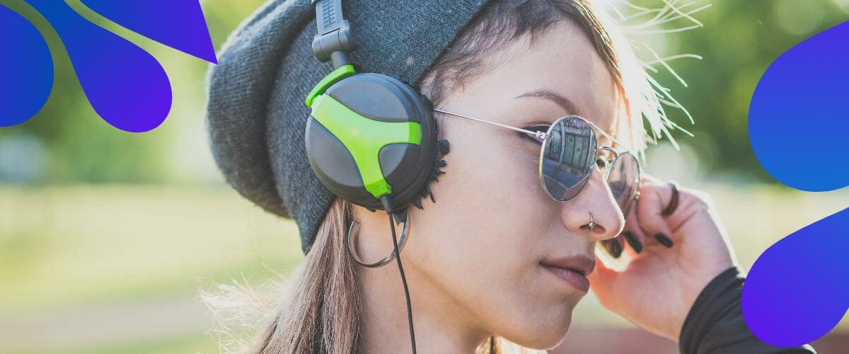 women listening to music with her headphone under $200
